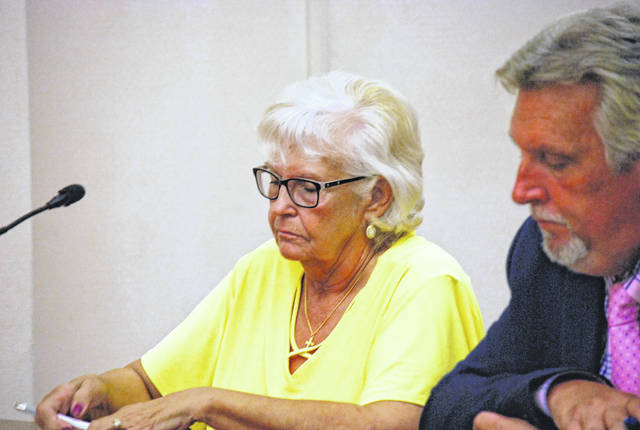 Emily Wrencher, 66, former executive director of the Crossroads Crisis Center, pleaded guilty Tuesday to stealing nearly $10,000 from the non-profit agency. She is pictured with her attorney, Robert Gryzbowski.