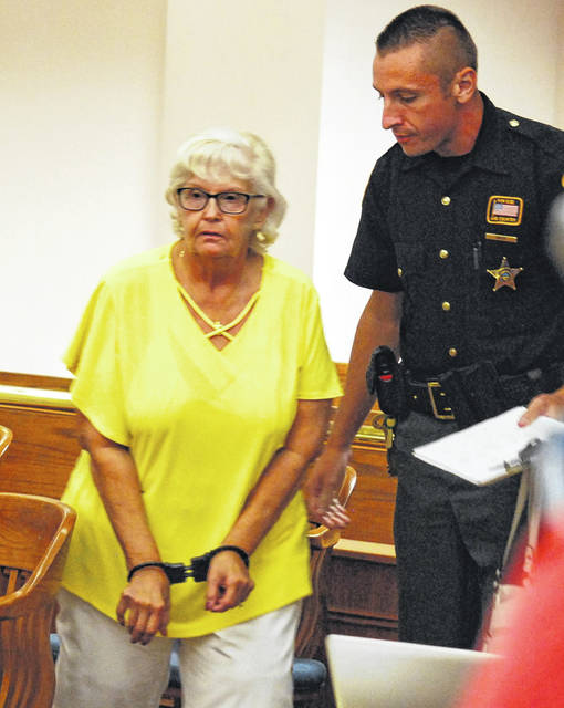 Emily Wrencher, former executive director of the Crossroads Crisis Center serving Allen and Hardin counties, was led from the courtroom in handcuffs Tuesday after being sentenced to 10 days in jail for stealing nearly $10,000 from the non-profit agency that provides shelter to victims of domestic abuse.