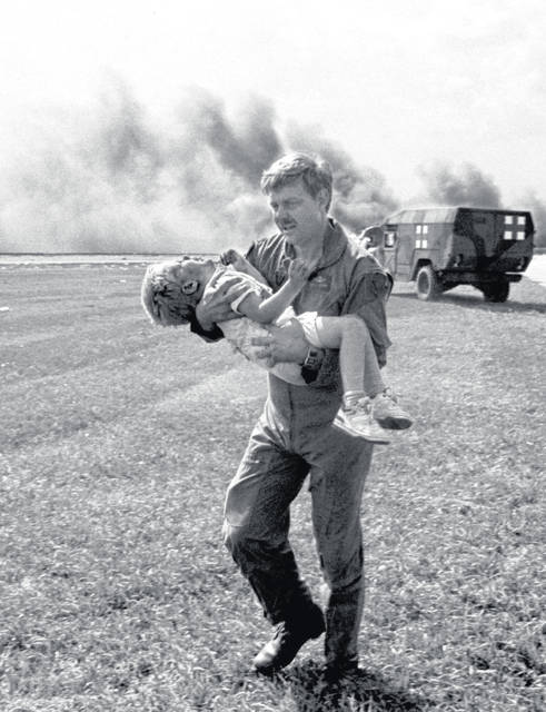 In this July 19, 1989 file photo, guardsman Dennis Nielsen carries passenger Spencer Bailey away from the wreckage of United Airlines Flight 232 after it crash landed in Sioux City, Iowa. Through the efforts of the flight crew and emergency personnel on the ground, 184 of the 296 passengers survived. (AP File Photo)