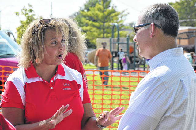 Lima schools superintendent Jill Ackerman discusses the upcoming school year with Ohio Education Association president Scott DiMauro at the Back to School event at Martin Luther King Jr. Center Park.