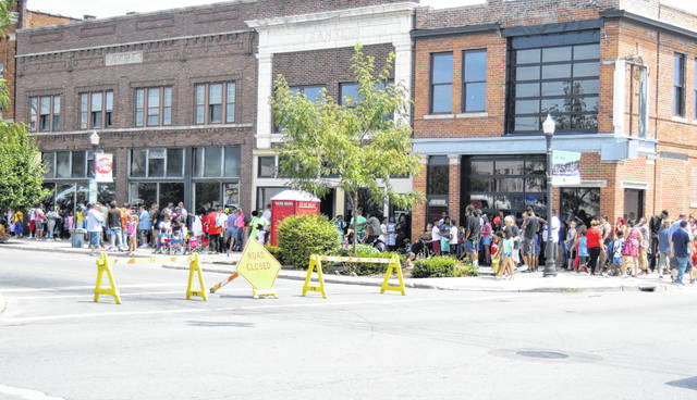 Hundreds of people waited in line for school supplies in downtown Lima on Sunday.
