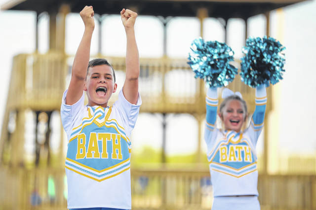 Trey Welsh, an eighth-grader cheering with Bath's junior varsity team, gets the crowd's attention during the annual cheerleading competition Wednesday night at the Allen County Fair.