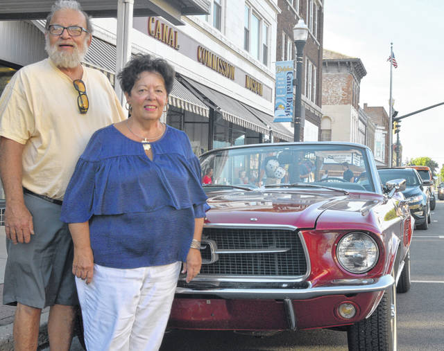 Ed and Kathy Ulrich pose next to their 1967 Ford Mustang.