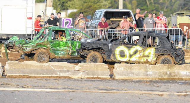 Wapakoneta's Tony Drexler, left, and Lima's Ryan Allen compete in Monday's Demolition Derby at the Allen County Fair.