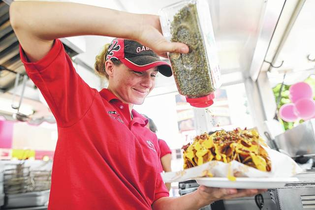 Danielle Fustaino, of Florida, prepares ribbon fries from Famous Gabby's Kitchen during a past Allen County Fair.