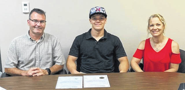 Don Goodes is joined at his University of Northwestern Ohio signing by parents Jeff and Jeanne Goodes.