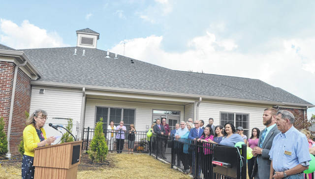 Joy Reichenbach, executive director of the Lima Convalescent Home Foundation, thanks the individuals who helped make the project possible during Thursday's ribbon-cutting event. Josh Ellerbrock Photo