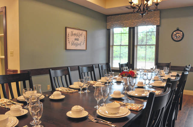 The dining table is set for both residents and staff members, who can sit together during meals. Josh Ellerbrock Photo