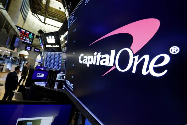 FILE - In this Tuesday, July 30, 2019, file photo, the logo for Capital One Financial appears above a trading post on the floor of the New York Stock Exchange. Data breaches through hacking attacks are common these days, and personal details about you can lead to identity theft, such as credit cards and loans in your name. Yet few victims can ever pin the blame on any specific breach, whether that's Equifax from 2017 or the recently disclosed breach at Capital One.
