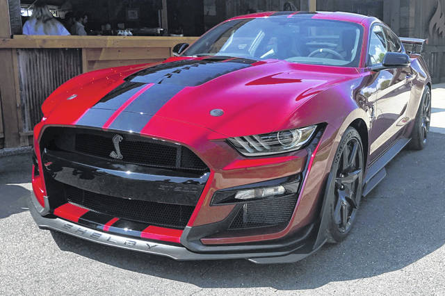The 2020 Shelby GT500 is displayed during a Ford press conference in the Detroit suburb of Clawson, Mich. The Mustang will be the most powerful street-legal Ford Mustang ever built and will go on sale this fall. (AP Photo/Tom Krisher)