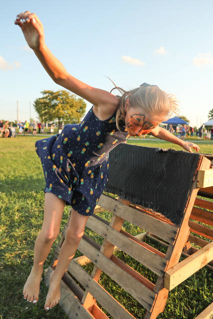 Nine-year-old Addison Ruwoldt, of Wapakoneta, completes an obstacle course during National Night Out at the Allen County Fairgrounds on Tuesday evening.