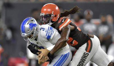 Browns linebacker Ray-Ray Armstrong sacks Detroit quarterback Tom Savage during Thursday night's  preseason game in Cleveland. (AP photo)