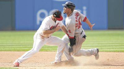 The Indians' Jason Kipnis, left, tags out Boston's Marco Hernandez at second base on a steal attempt during Wednesday's game in Cleveland.