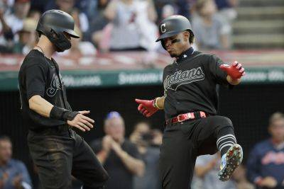 The Indians' Francisco Lindor, right, and Tyler Naquin celebrate after Lindor hit a two-run home run during Friday night's game against Kansas City in Cleveland. (AP photo)