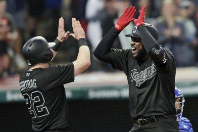 The Indians' Franmil Reyes, right, is congratulated by Jason Kipnis after hitting a three-run home run during Saturday night's game against Kansas City in Cleveland. (AP photo)