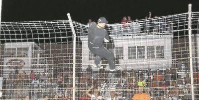 Tony Anderson climbs the fence in celebration of winning the Bud Thunderstock championship Friday night at Limaland Motorsports Park. Mike Campbell photo