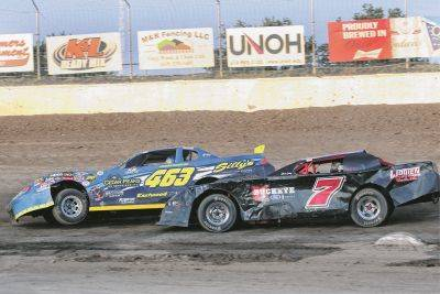 Dan Wooten (7) tries to pass Daniel Sanchez during Friday night racing at Limaland Motorsports Park. Brent Pierce Photo