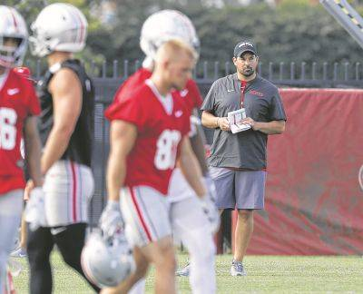 Ohio State head coach Ryan Day watches players run drills Friday in Columbus.