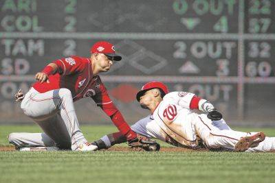 The Nationals' Juan Soto safely reaches second base during a stolen base attempt against Cincinnati's Jose Iglesias during Wednesday's game in Washington.