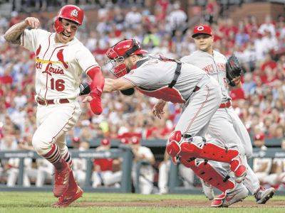 Cardinals defeat Reds in Game 1 of doubleheader