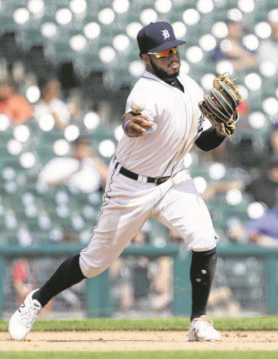 Tigers third baseman Dawel Lugo throws out the Chicago White Sox's Tim Anderson at second base during Wednesday's game in Detroit.