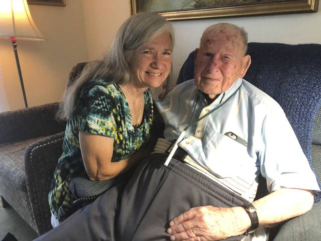 Retired chemist Robert Walton, 103, reminisces about his work during World War II helping expand production of penicillin at Merck & Co. in New Jersey, along with his daughter, Wendy Walton Reichenbach, on Monday, July 29, 2019, in Columbus, Ohio. An Ohio chapter of the Military Order Of The Purple Heart has asked Walton to lay a wreath at the group's monument at the National Veterans Memorial and Museum Aug. 7, which is national Purple Heart Day, in honor of his work on penicillin and the lives it saved during war time.