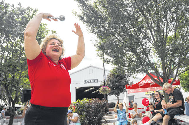 Shelley Graf, the first female drum major at Ohio State, gets the crowd excited for the opening of the 2019 Allen County Fair on Friday evening. Graf performed with the Ohio State University Alumni Band.
