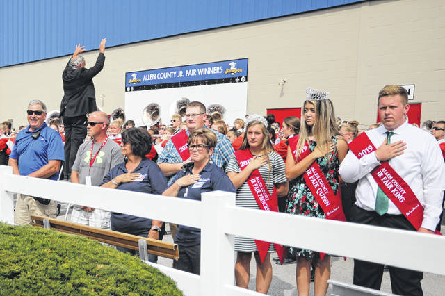 The Elida High School band performs the National Anthem for the opening of the 2019 Allen County Fair on Friday afternoon, while fair royalty including queen Ashley Huck, second from right, and king Brandon Suever, right, stand at attention. The fair runs through Saturday, Aug. 24.