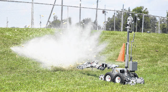 The Allen County Regional Bomb Squad held a demonstration at the Allen County Fair on Sunday. Melons were used to simulate damage from a bomb.