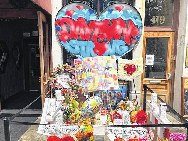 A makeshift memorial sits outside Ned Peppers nightclub in the Oregon District entertainment neighborhood where on Aug. 4 a gunman killed nine people, on Wednesday, Aug. 14, 2019, in Dayton.