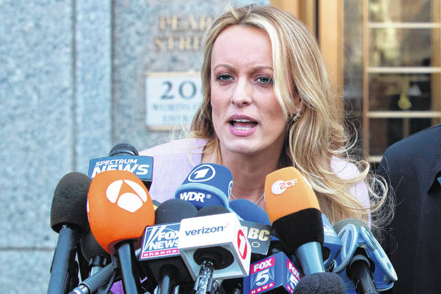 FILE - In this April 16, 2018, file photo, adult film actress Stormy Daniels speaks outside federal court in New York. Columbus police say five officers from the department's now-disbanded vice unit face discipline for the 2018 raid on a strip club that resulted in the arrest of Stormy Daniels. The department said Wednesday, July 31, 2019, that the officers could face punishment ranging from a reprimand to firing. The officers include a commander, lieutenant, sergeant and two of the arresting officers.