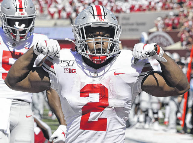 Ohio State running back J.K. Dobbins (2) celebrates after scoring a touchdown during Saturday's game against Indiana in Bloomington, Ind.
