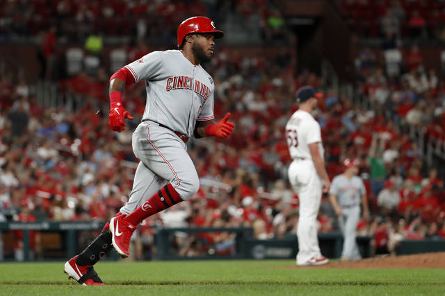 Cincinnati Reds' Phillip Ervin, left, rounds the bases after hitting a solo home run off St. Louis Cardinals pitcher Mike Mayers during the sixth inning in the second baseball game of a doubleheader Sunday, Sept. 1, 2019, in St. Louis. (AP Photo/Jeff Roberson)