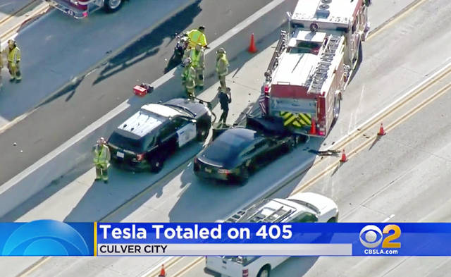 FILE - This Jan. 22, 2018, file still frame from video provided by KCBS-TV shows a Tesla Model S electric car that has crashed into a fire engine on Interstate 405 in Culver City, Calif. A government report says the driver of the Tesla that slammed into a firetruck was using the car's Autopilot system when a vehicle in front of him suddenly changed lanes and he didn't have time to react. The National Transportation Safety Board said Tuesday, Sept. 3, 2019, that the driver never saw the parked firetruck and didn't brake. (KCBS-TV via AP, File)