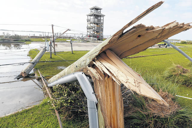 Utility poles were shipped Saturday after Hurricane Dorian moved through the area of Nags Head, N.C.