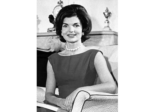 """FILE - This March 27, 1960 photo shows Jacqueline Kennedy posing in the living room of her residence in Washington, D.C. """"Camera Girl: How Miss Bouvier Used Imagination & Subversion To Invent Jackie Kennedy,"""" a book on Kennedy's early years as a columnist, is scheduled to come out in Spring 2021, Gallery Books announced Thursday, Sept. 12. (AP Photo, File)"""