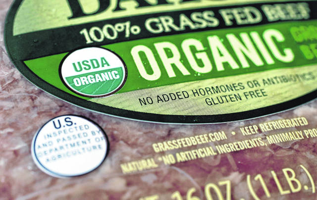 """A """"USDA Organic"""" label is printed on the label of a pound of ground beef, in Walpole, Mass. Labels such as """"Fair Trade Certified """" or """"USDA Organic"""" signify that a product's supply chain has gone through some level of vetting. However, standards can vary widely."""