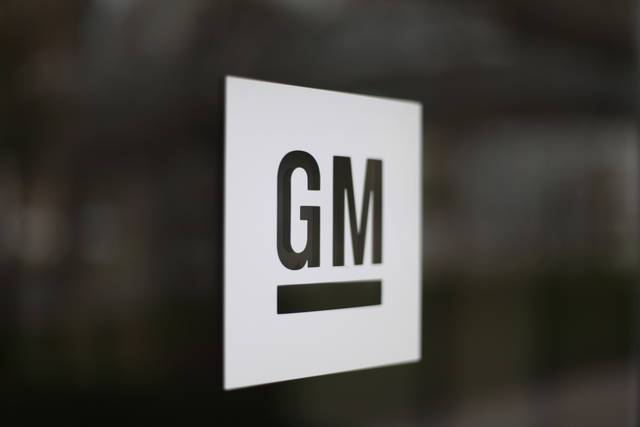 FILE - This May 16, 2014, file photo shows the General Motors logo at the company's world headquarters in Detroit. The United Auto Workers union is letting its contract with General Motors expire just before midnight Saturday, Sept. 14, 2019, increasing the likelihood of a strike as early as Sunday night. (AP Photo/Paul Sancya, File)