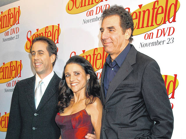 """Jerry Seinfeld, left, Julia Louis Dreyfus and Michael Richards arrive to celebrate the release of the first three seasons of Seinfeld on DVD in New York in 2004. Netflix says it will start streaming all 180 episodes of the """"Seinfeld"""" in 2021, gaining a hugely popular addition to its library as the battle for viewers heats up."""