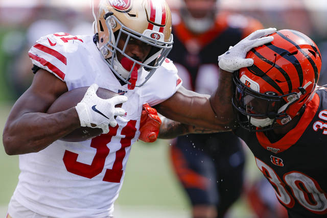 San Francisco 49ers running back Raheem Mostert (31) runs the ball against Cincinnati Bengals free safety Jessie Bates (30) during the second half an NFL football game Sunday, Sept. 15, 2019, in Cincinnati. (AP Photo/Gary Landers)