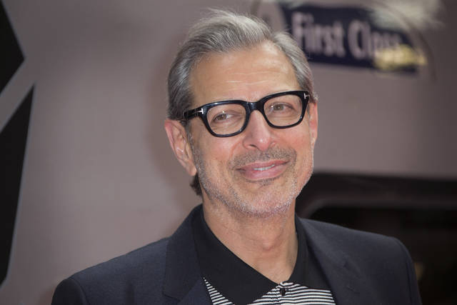"FILE - In this June 6, 2016, file photo, actor Jeff Goldblum poses for photographers at the photo call for the film Independence Day Resurgence at Euston Station in London.  Goldblum, Laura Dern and Sam Neill will reprise their ""Jurassic Park"" roles in the upcoming ""Jurassic World 3."" Their castings were announced Tuesday, Sept. 24, 2019 by executive producer and director Colin Trevorrow.   (Photo by Joel Ryan/Invision/AP, File)"