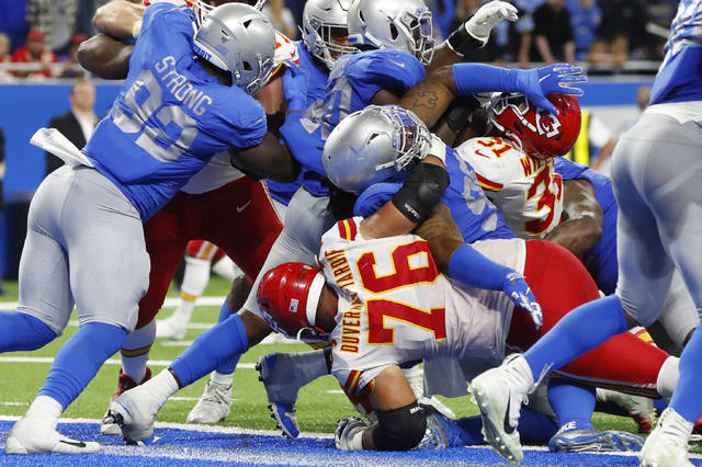 The Detroit Lions defense attempts to stop Kansas City Chiefs running back Darrel Williams (31) from scoring on a 1-yard run during the second half of an NFL football game, Sunday, Sept. 29, 2019, in Detroit. (AP Photo/Paul Sancya)