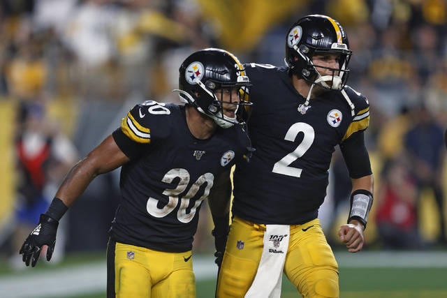 Pittsburgh Steelers running back James Conner (30) celebrates his touchdown with quarterback Mason Rudolph during the first half of an NFL football game in Pittsburgh, Monday, Sept. 30, 2019. (AP Photo/Tom Puskar)