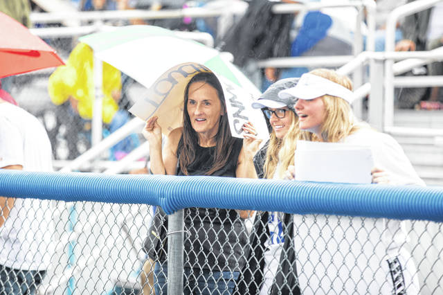 Spectators at Friday night's game between Spencerville and Allen East had to endure wet conditions and a delayed start to the game due to lightning.