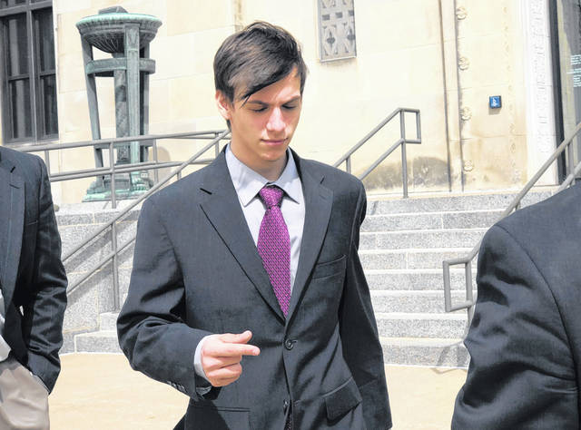 FILE - In this April 3, 2019, file photo, Casey Viner, an Ohio gamer accused of recruiting a prankster to make a bogus emergency call, leaves federal court in Wichita, Kansas, after changing his plea to guilty for his alleged part in the hoax that got an unarmed Kansas man killed by police.
