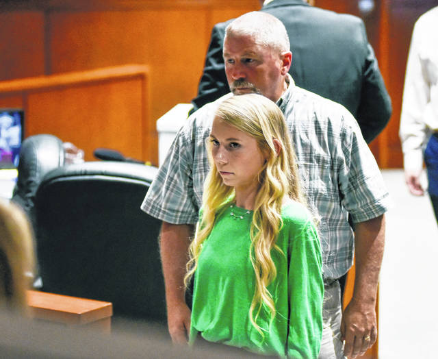 Brooke Skylar Richardson leaves the courtroom with her father, Scott Richardson, during a break in her trial Wednesday, Sept. 4, 2019, at the Warren County Courthouse, in Lebanon, Ohio. Richardson, accused of killing and burying her newborn daughter, has pleaded not guilty to aggravated murder and other charges.