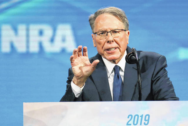 FILE - In this Friday, April 26, 2019 file photo, National Rifle Association Executive Vice President Wayne LaPierre speaks at the National Rifle Association Institute for Legislative Action Leadership Forum in Lucas Oil Stadium in Indianapolis. The National Rifle Association is meeting in the shadows of Congress as its leaders remain under fire for spending and its operations. Amid the turmoil, lawmakers are considering steps to stem gun violence, including proposals long opposed by the NRA.