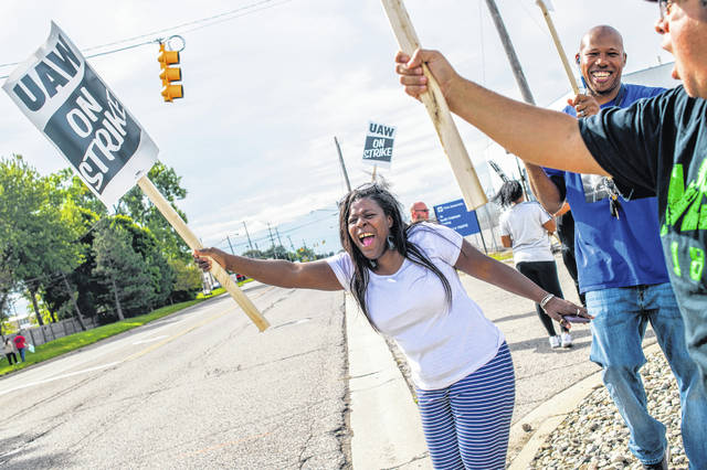 Flint resident Dorrit Madison, who has worked at the plant for more than 11 years, shouts out at cars passing by as General Motors employees demonstrate outside of the Flint Assembly Plant on Sunday, Sept. 15, 2019 in Flint. GM autoworkers in Lansing officially go on strike at midnight Sunday after UAW leadership voted to do so Sunday morning.
