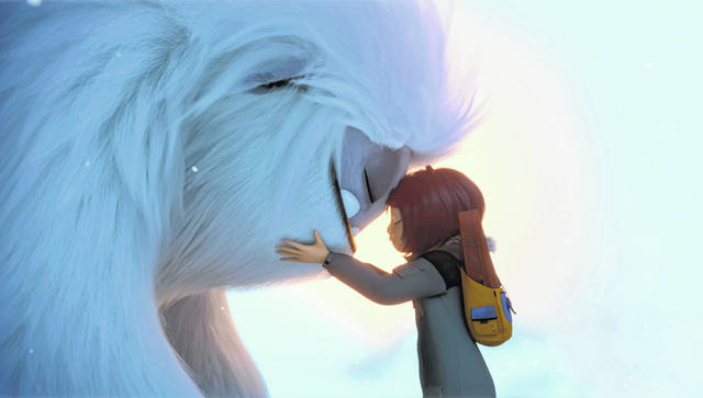 "This image released by DreamWorks Animation shows Everest the Yeti, left, and Yi, voiced by Chloe Bennet, in a scene from ""Abominable,"" in theaters on Sept. 27."