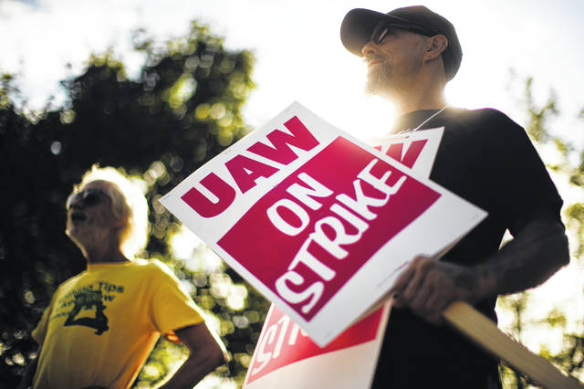 FILE - In this Sept. 16, 2019 file photo, union members picket outside a General Motors facility in Langhorne, Pa. The strike against GM by United Auto Workers entered its second week Monday, Sept. 23 with progress reported in negotiations but no clear end in sight. Bargainers met all weekend and returned to talks Monday morning as the strike entered its eighth day.